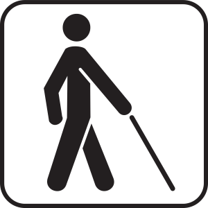 """Placa com bonequinho com um bengala símbolo do deficiente visual. Quem é """"cego?"""