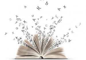 Livro aberto e letras e palavras voando. As Palavras foram desacopladas do Papel?